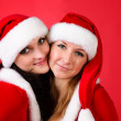 Two girl friends in christmass costumes — Φωτογραφία Αρχείου