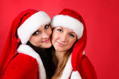 Two girl friends in christmass costumes — Stock Photo