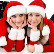 Two girl friends in christmass costumes. — Stock Photo