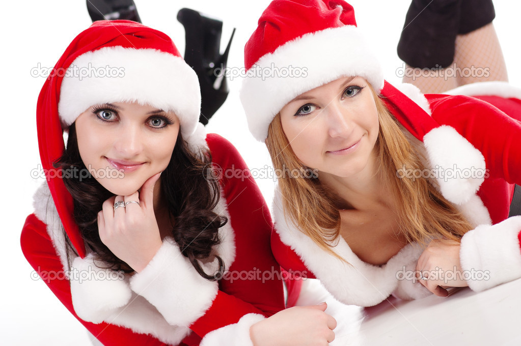 Two girl friends in christmass costumes. Isolated over white background — Stock Photo #4003289
