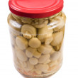 Marinaded mushrooms in a glass jar . — Stock Photo