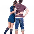 Young couple looks where that. Rear view. - Foto Stock