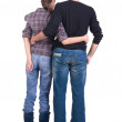 Young couple looks where that. Rear view. — Stock Photo #4372285