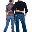 Young couple looks where that. Rear view. — Stock Photo #4461291