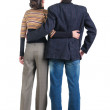 Young couple looks where that. Rear view — Stock Photo