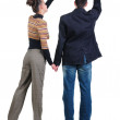 Young couple pointing at wall. Rear view. — Stock Photo #4461419