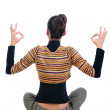 Royalty-Free Stock Photo: Beautiful businesswoman exercising yoga .rear view