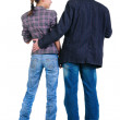 Royalty-Free Stock Photo: Young couple looks where that. Rear view.