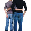 Stock Photo: Young couple looks where that. Rear view.