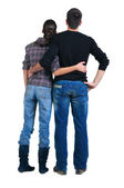 Young couple looks where that. Rear view. — Stock Photo