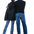 Young couple looks where that. Rear view. — Stock Photo #4649887