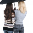 Two women under an umbrella. Rear view. — Stock Photo #5188412