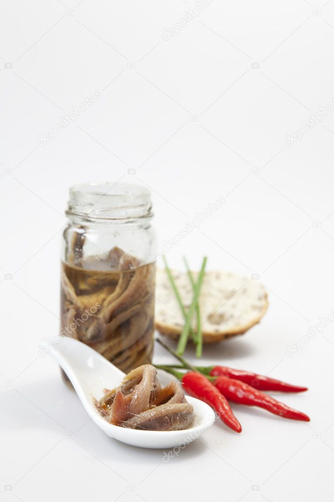 Delicious salted anchovies with oil on white background — Stock Photo #5103969