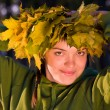 Girl in wreath of leaves — Stock Photo