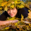 Girl in wreath of leaves - Stok fotoğraf