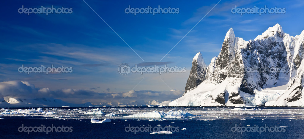 Beautiful snow-capped mountains against the blue sky in Antarctica  Stock Photo #4468931