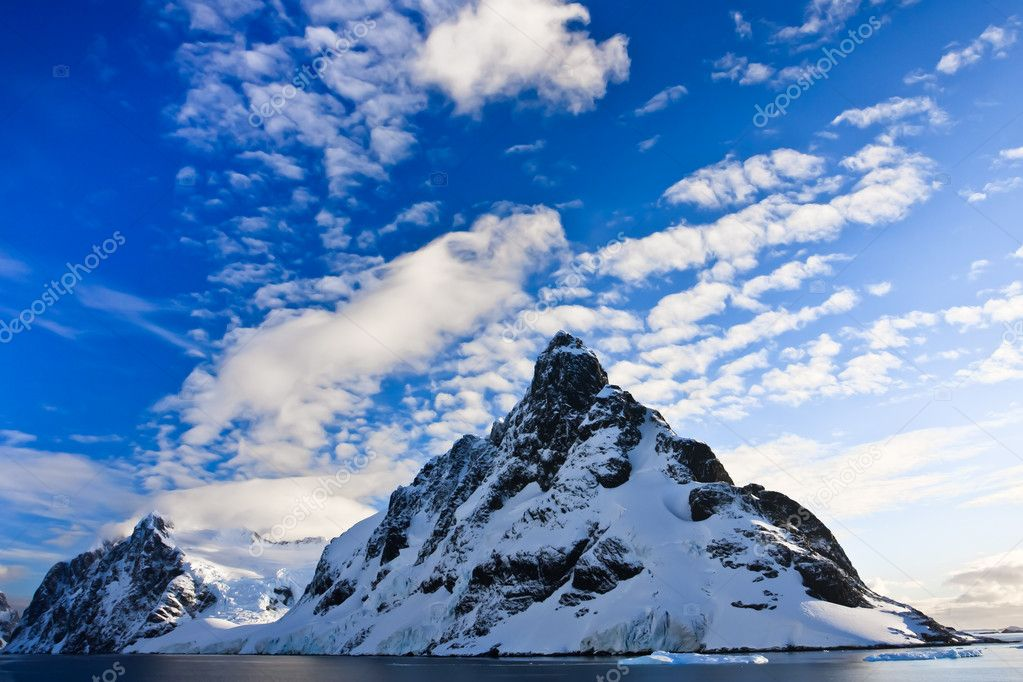 Beautiful snow-capped mountains against the blue sky in Antarctica  Stock Photo #4468933