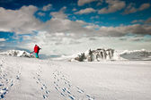 Man climbs on a snow slope — Stock Photo