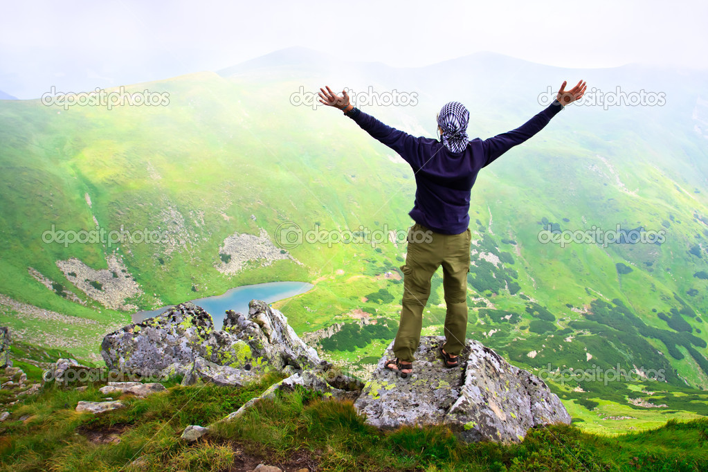 Beautiful mountains landscape with lake  in Carpathian mountains and man on the top — Stock Photo #4993313