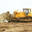 Stock Photo: Yellow bulldozer working in winter