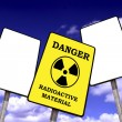 Radioactivity billboard on a blue sky with clouds — Stock Photo