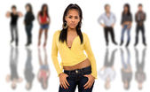 Beautiful african young girl in front of a group of , isolated — Stock Photo