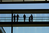 In silhouette at a modern building — Stock Photo