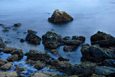 Long Exposure of sea over rocks - dreamy feel — Stock Photo