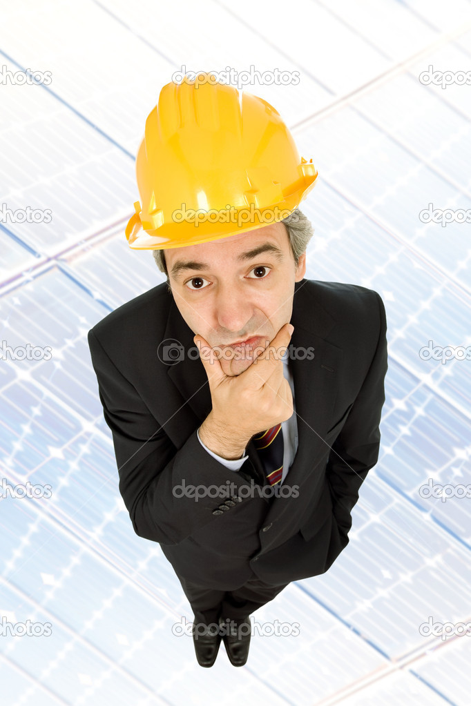An engineer with yellow hat thinking looking up — Stock Photo #4870678