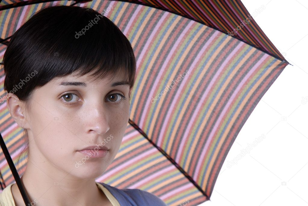 Young brunette girl with umbrella in colors  Stock Photo #4871334
