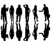 Young business team in silouette, isolated on white — Stock Photo