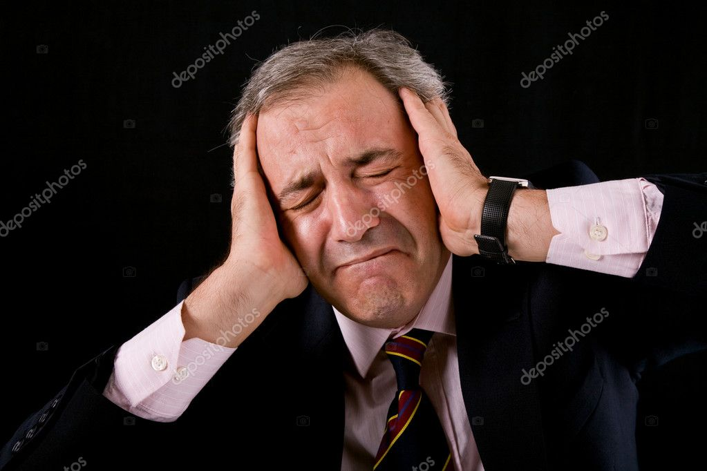 Sad mature business man on a black background — Stock Photo #4883526