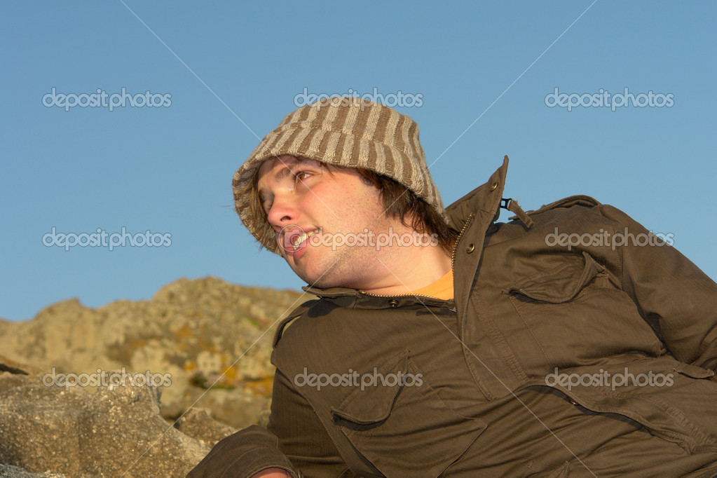 Relaxed young man portrait outdoor with a hat  Stock Photo #4887154