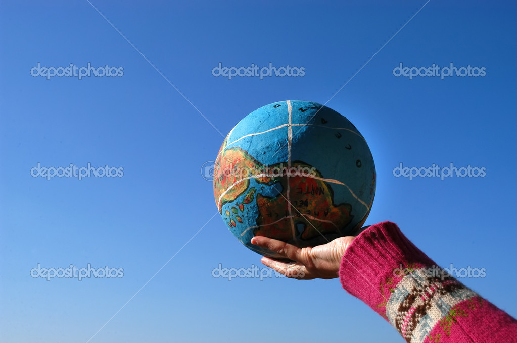 Globe in the hand  Stock Photo #4889115