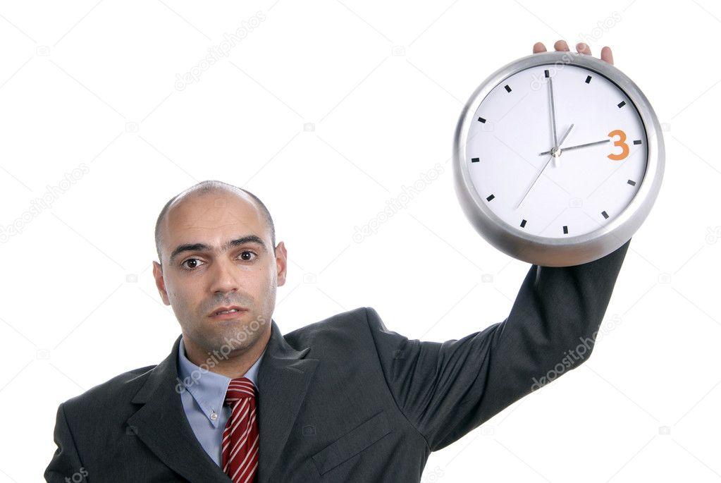 A handsome business man holding a clock  Stock Photo #4894306