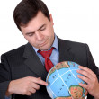 Stock Photo: Holding a globe