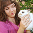 Girl with a white rabbit — Stock Photo