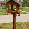 Wooden starling-house in a park — Stock Photo