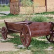 Wooden cart in a park — Stock Photo