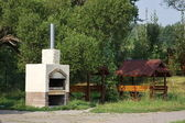 Russian stove and arbour in a park — Stock Photo