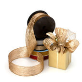 Festive gift box and wrapping ribbons — Stock Photo