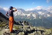 Girl looking to far mountains — Stock Photo