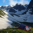 Tent on meadow in the mountains — Stock Photo