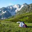 Camp in the high mountains - Stock Photo