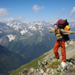 Happy backpacker girl in mountains — Stock Photo #5178654