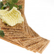 Diet crackers with parsley and butter. — Stock Photo