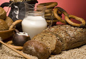 Close-up with cereal bread,grains,milk and boubliks. — Stock Photo
