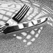 Fork and knife on a plate — Stock Photo