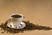 Coffee drink with beans — Stock Photo