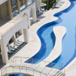 Luxury hotels with curve beautiful water pool - Stock Photo